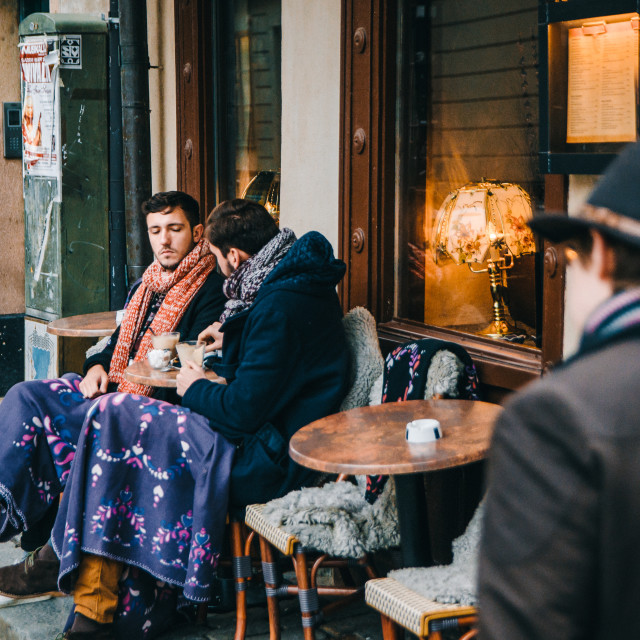 """Two men drink a coffee in the outdoor cafe, Stockholm"" stock image"