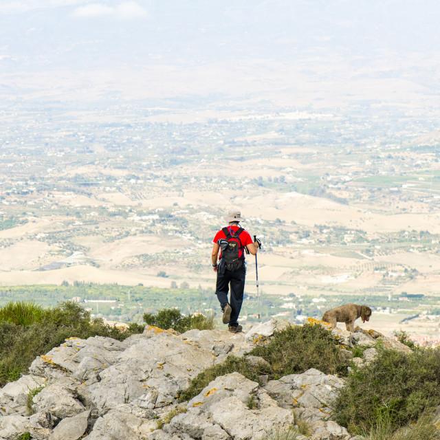 """Man hiking through Karstic limestone mountains"" stock image"