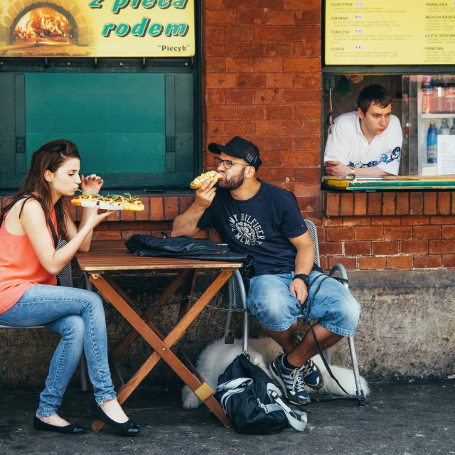 """Couple, seller and polish fastfood - zapekanka on Nowy Square"" stock image"