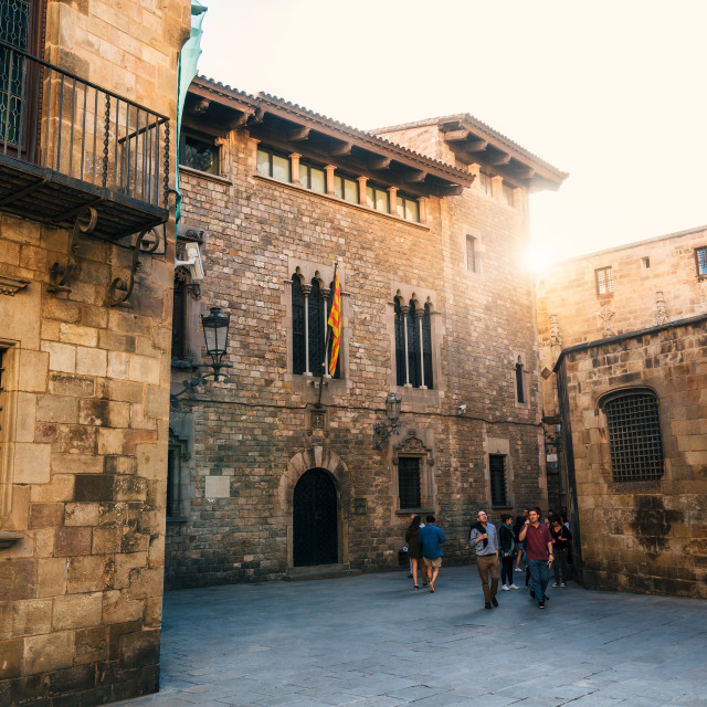 """Gothic quarter of Barcelona with tourists at sunset, Spain"" stock image"