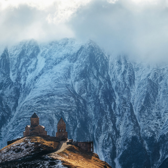 """Caucasus mountains, Gergeti Trinity church, Georgia"" stock image"