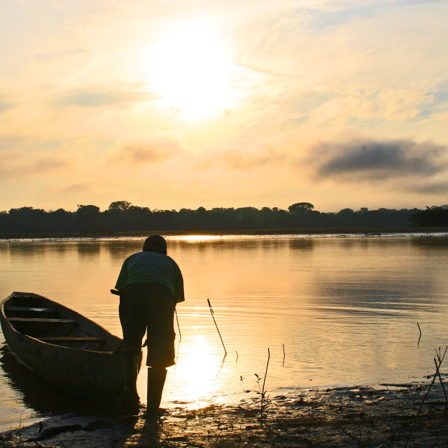 """""""Antonio and a dugout canoe"""" stock image"""