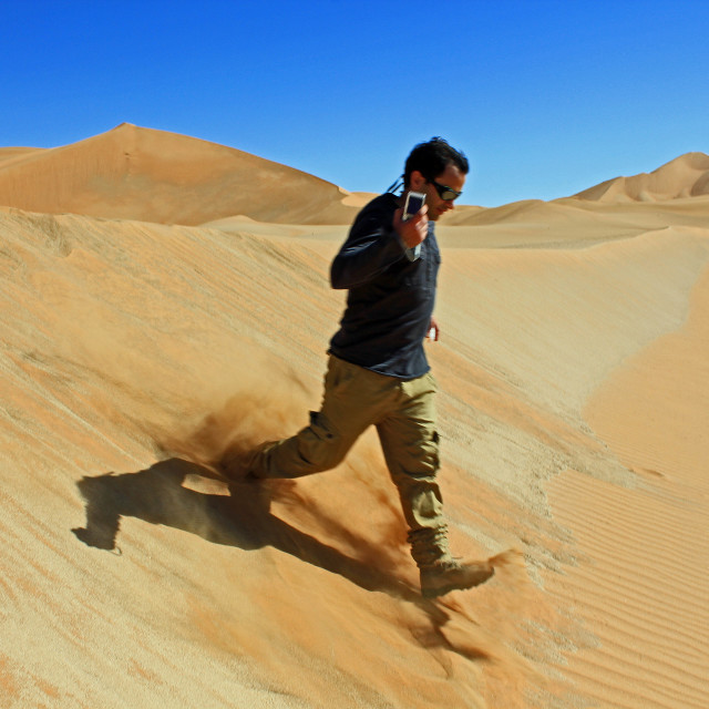 """Running down a sand dune"" stock image"