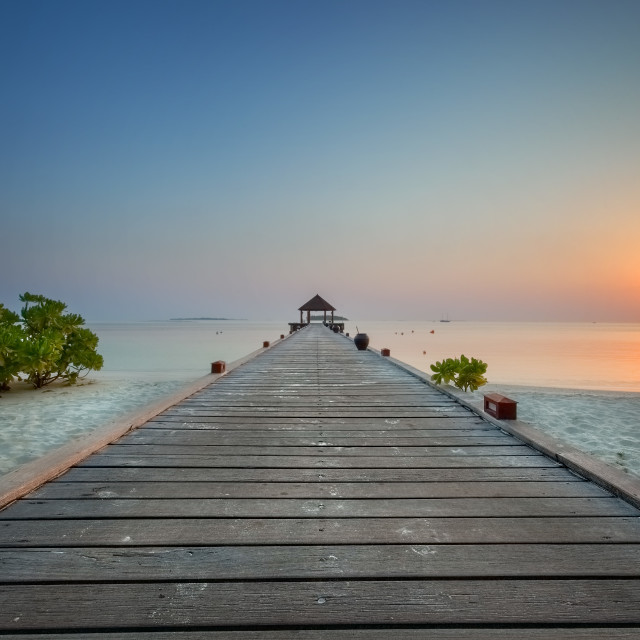 """Boat Jetty at Sunrise in the Maldives"" stock image"