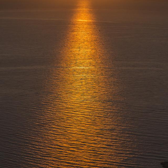 """Yellow sun reflection during sunrise"" stock image"