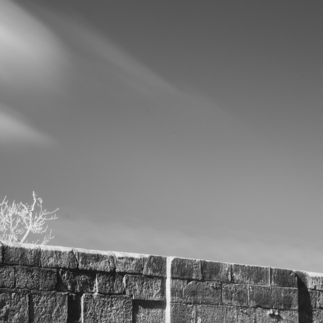 """""""Stone wall and sky"""" stock image"""