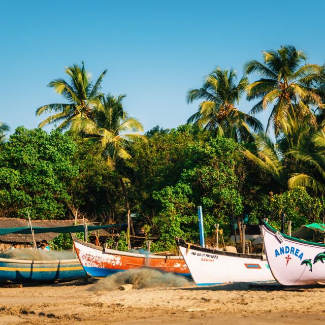 """Wooden fishing boats on Morjim beach, North Goa, India"" stock image"