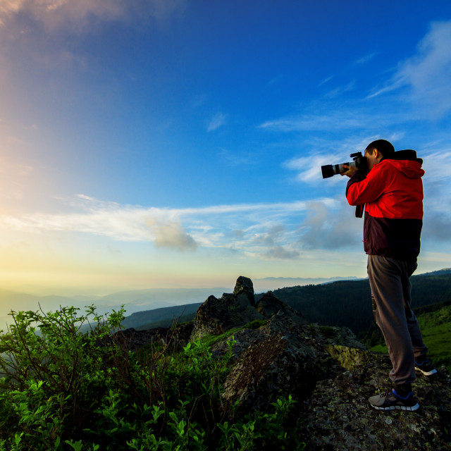 """""""men hiking photographer take a picture"""" stock image"""