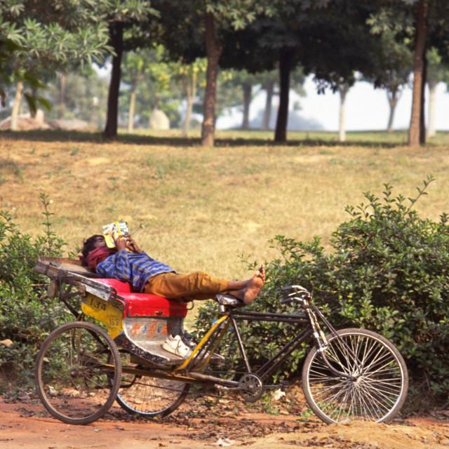 """""""Rickshaw Rider Relaxing"""" stock image"""