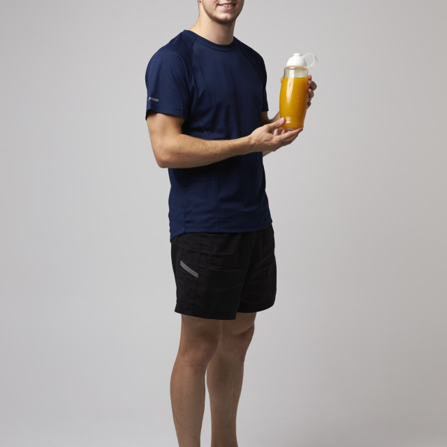 """Studio Portrait Of Male Nutritionist With Drinks Bottle"" stock image"