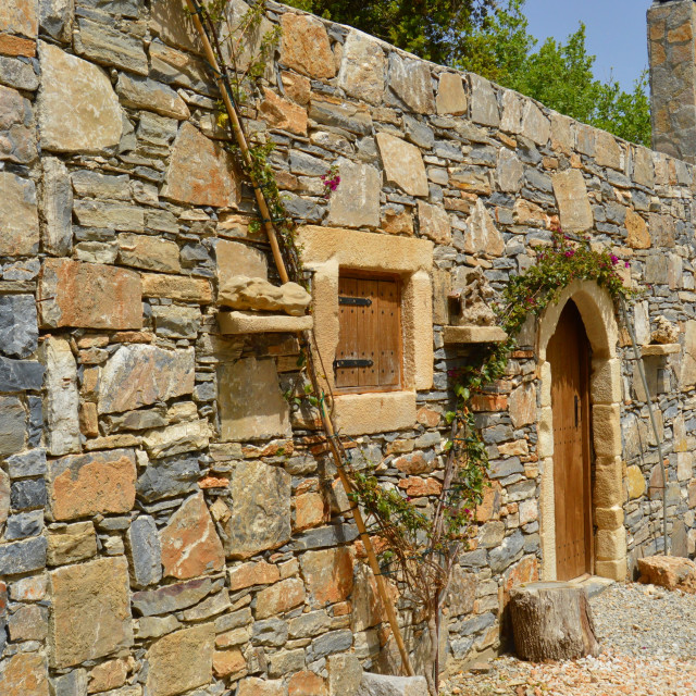 """Blue stone Cretan typical house."" stock image"