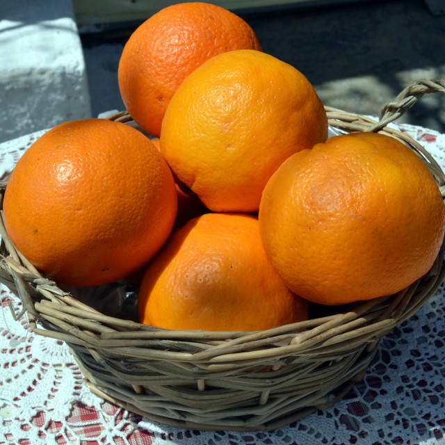"""Several oranges bios in a basket in wicker."" stock image"