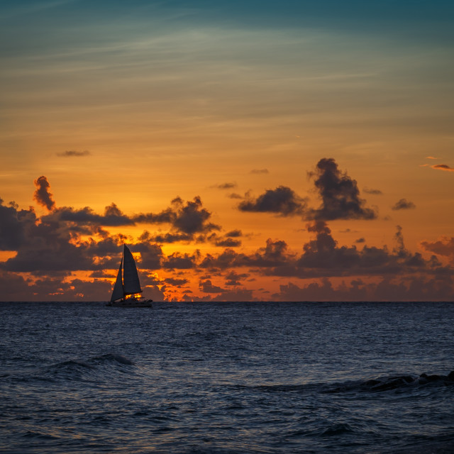 """Sailing into the sunset."" stock image"