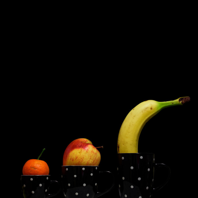 """""""Diet and funny Coffee Time, fruit cup with a black square background. Cups of tea, coffee and herbal tea with fruit."""" stock image"""