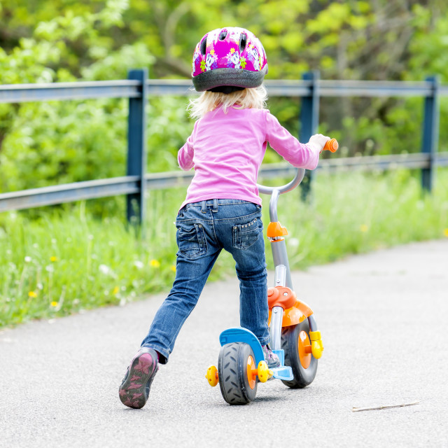 """little girl with a scooter"" stock image"