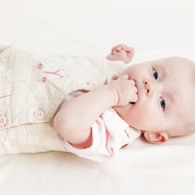 """portrait of lying four months old baby girl"" stock image"