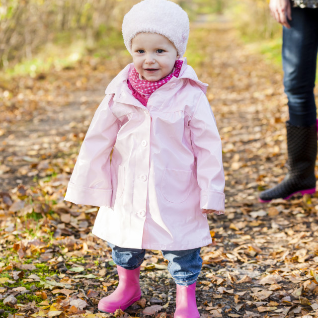 """little girl wearing rubber boots in autumnal nature"" stock image"