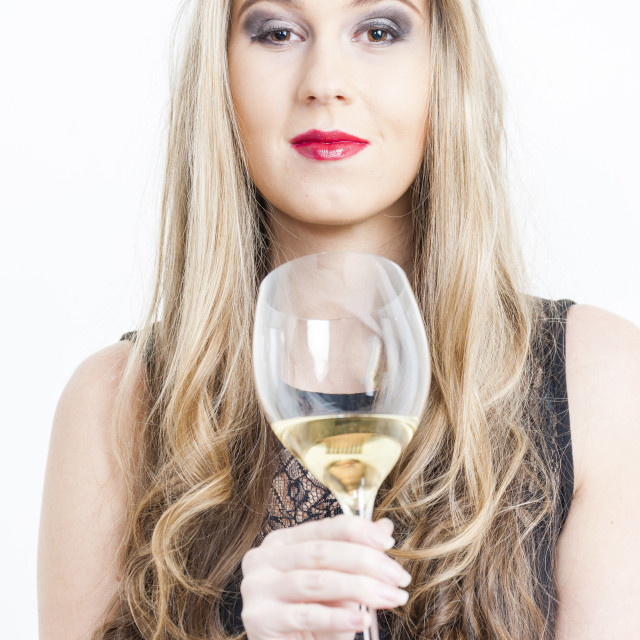 """portrait of young woman with a glass of white wine"" stock image"