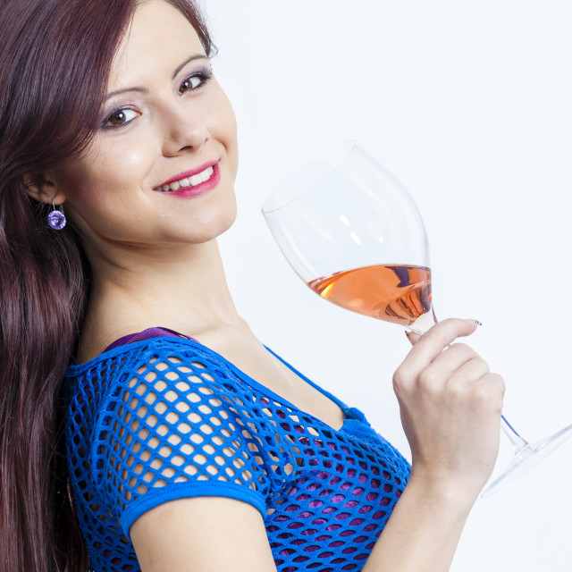 """portrait of young woman with a glass of rose wine"" stock image"