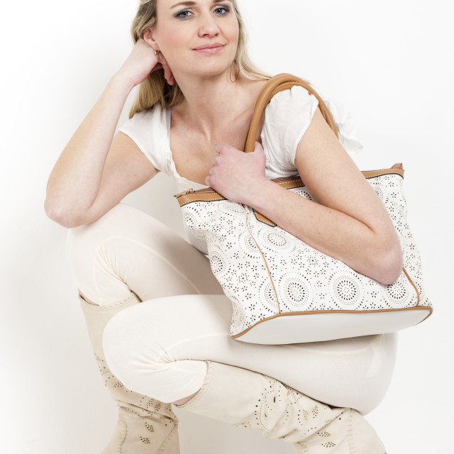 """woman wearing summer boots with a handbag"" stock image"