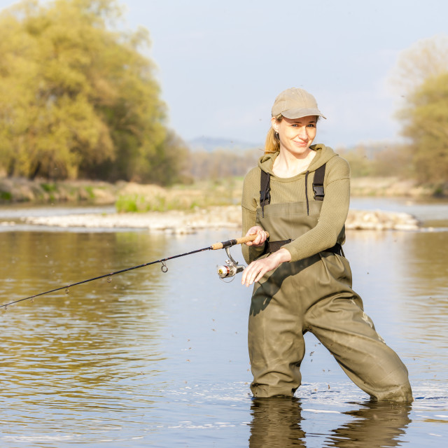 """woman fishing in the river in spring"" stock image"