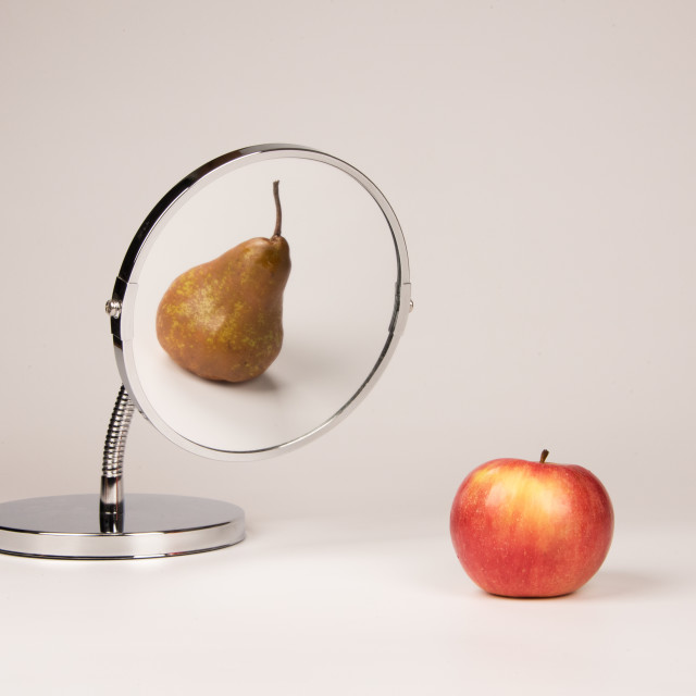 """Strange mirror reflecting apple and pear"" stock image"
