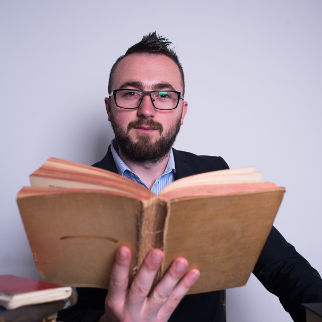 """""""man with old book in hands"""" stock image"""