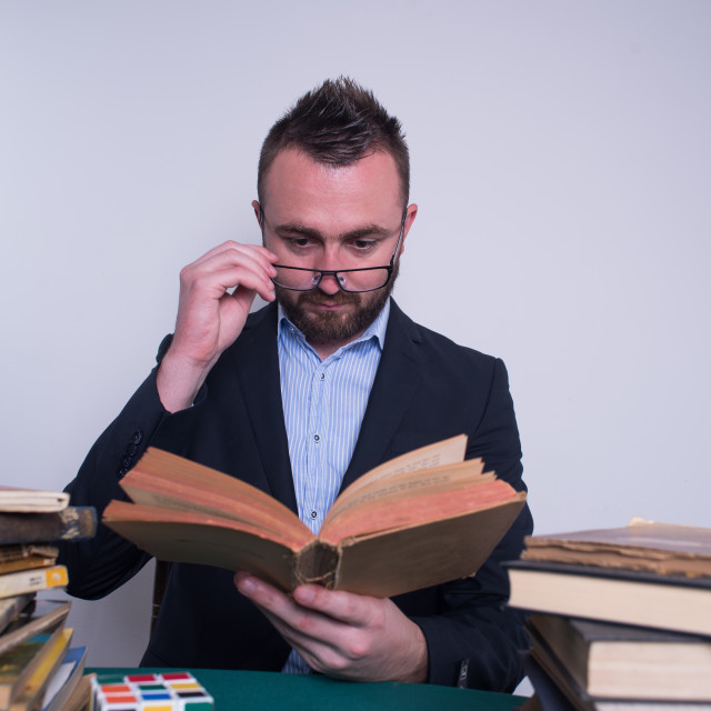 """""""professor reading from an old book"""" stock image"""