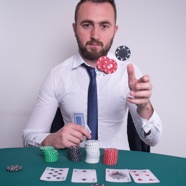 """""""poker player trowing chips"""" stock image"""