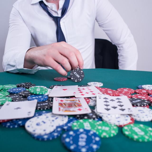 """hand holding chip for poker"" stock image"