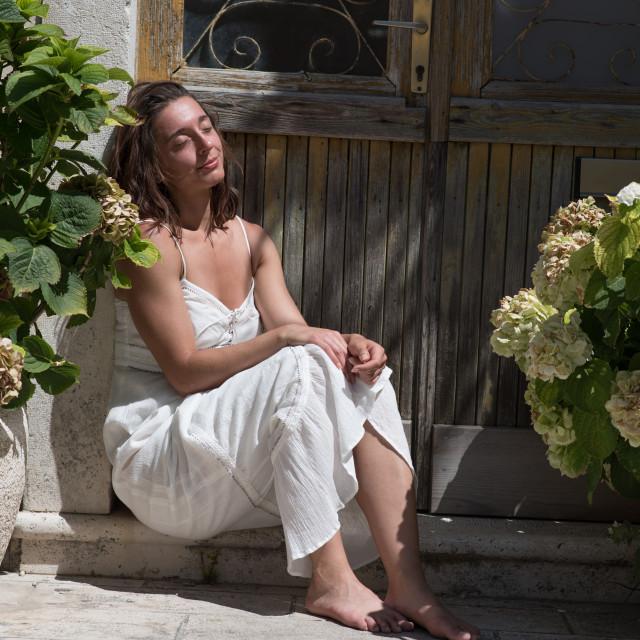 """enjoying sun on door steps"" stock image"