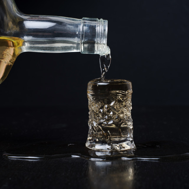 """alcohol spilling over glass"" stock image"