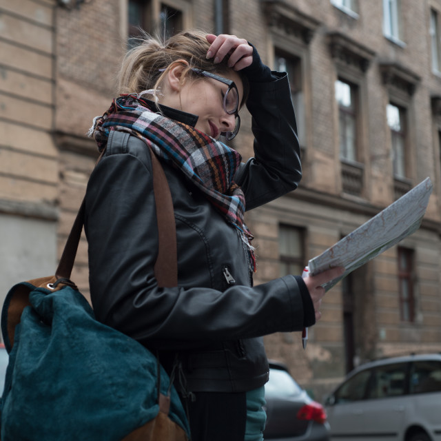"""woman looking at map on street"" stock image"