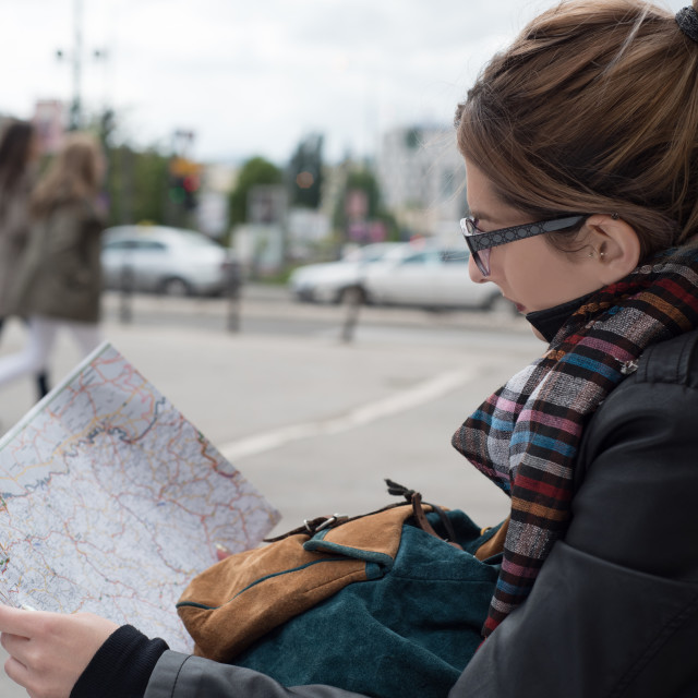 """girl looking at map"" stock image"