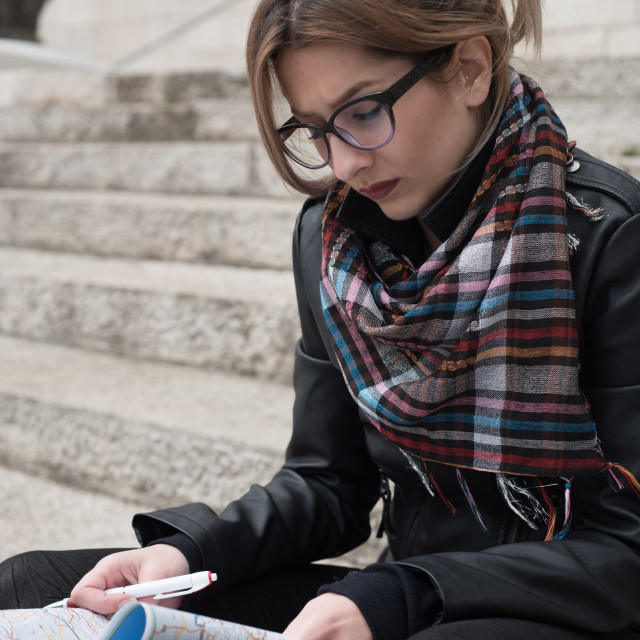 """young woman looking at map"" stock image"