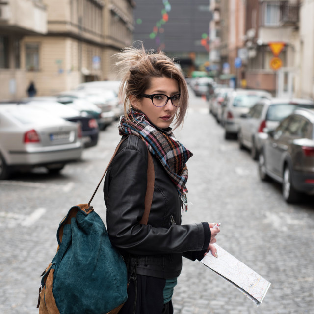 """young woman on street with travel map in hand"" stock image"