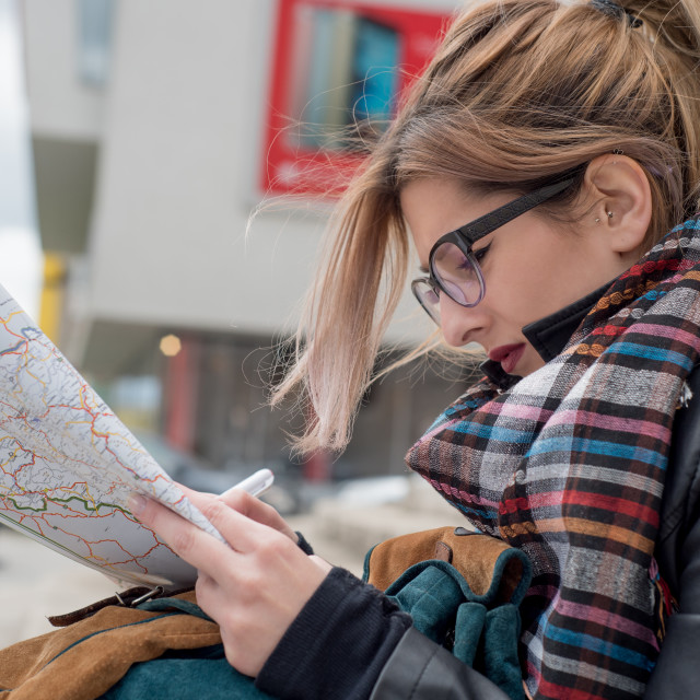 """girl looking at travel map"" stock image"