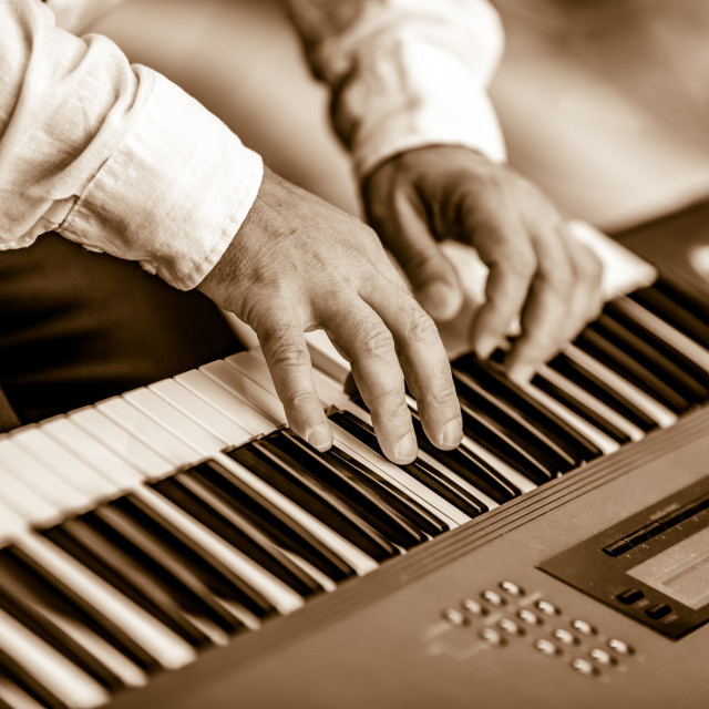 """Hands of male keyboard player performing live jazz music"" stock image"