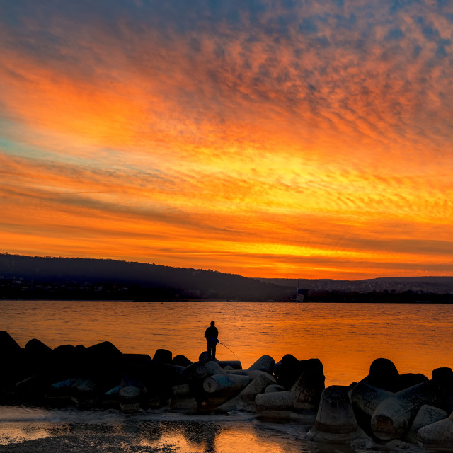 """Fishing at amazing sunset"" stock image"