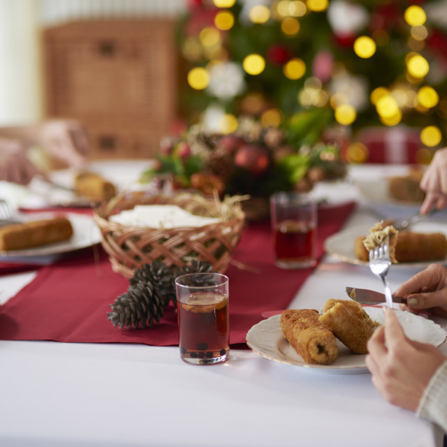 """People eating croquette over Christmas table"" stock image"