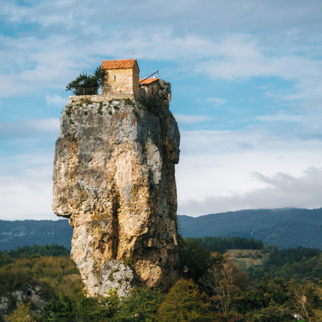 """Katskhi pillar. Georgian landmarks. The church on a rocky cliff."" stock image"