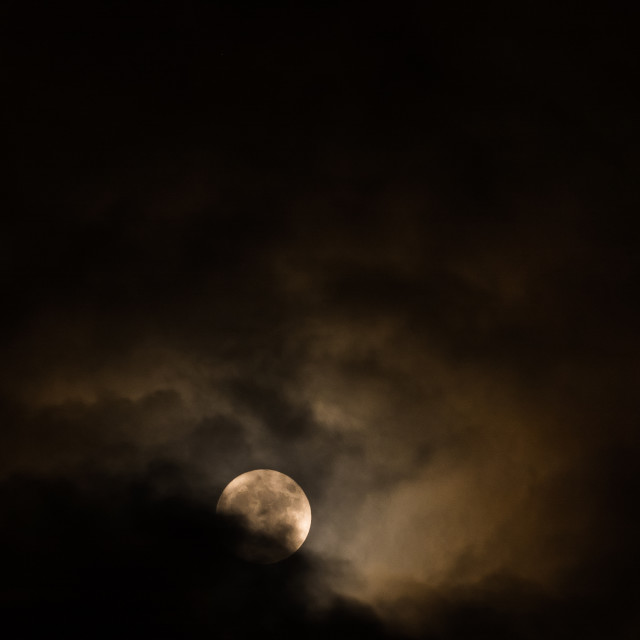 """Supermoon and Clouds"" stock image"