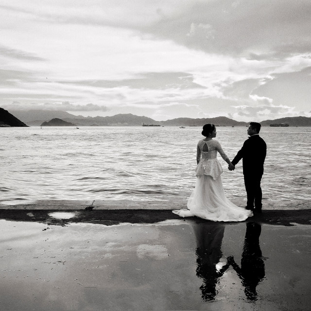 """Wedding shooting in harbourfront Hong Kong"" stock image"