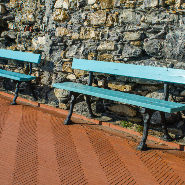 """""""Two Benches At The Wall"""" stock image"""