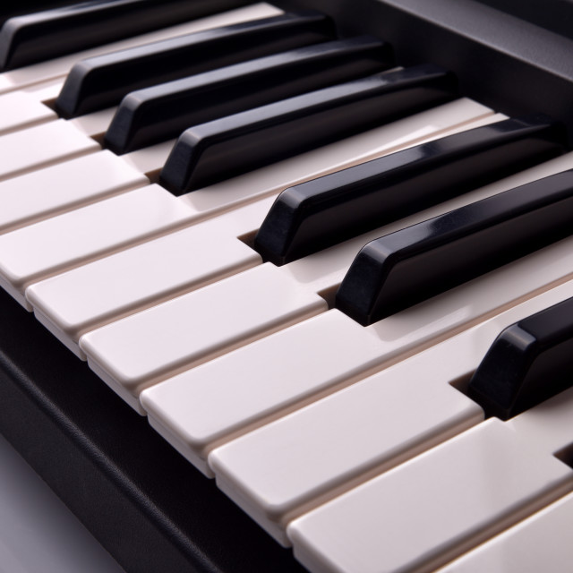 """Electronic piano keyboard elevated view"" stock image"