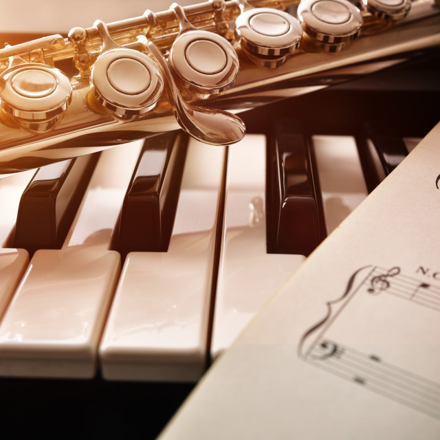 """Piano and flute with golden shine and sheet music front"" stock image"