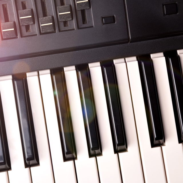 """Synthesizer keyboard with shine top view"" stock image"