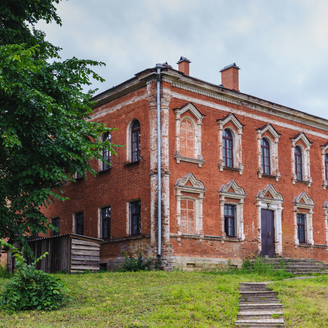 """""""Red bricks Russian building on the green grass"""" stock image"""