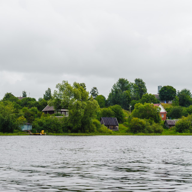 """""""Panorama of the green plants and houses side of the river"""" stock image"""