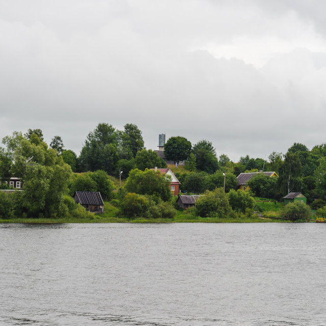 """Panorama of the green plants and houses side of the river"" stock image"